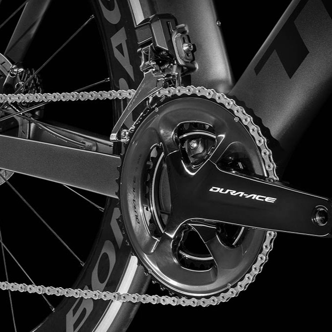 A studio photo of a Shimano Dura-Ace crankset on a bike
