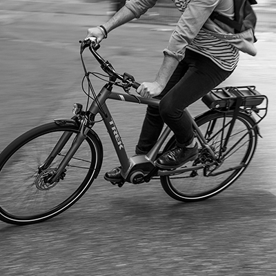 Photo of a person riding a Trek electric bike on a street