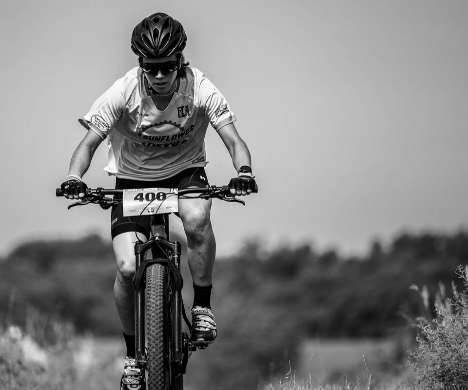 NICA racer riding a bike.