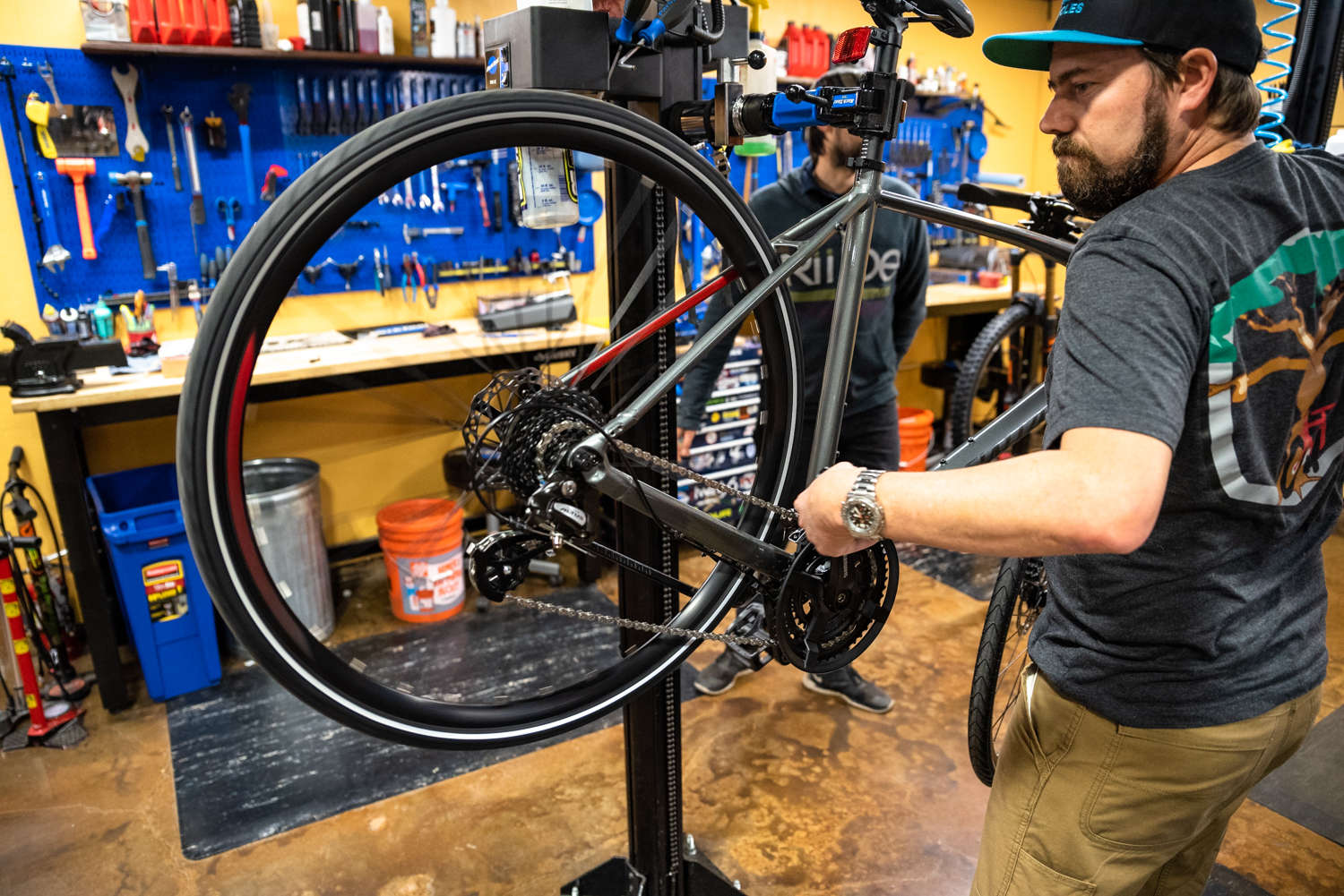 Lars Thomsen servicing bike shifting at trail head cyclery