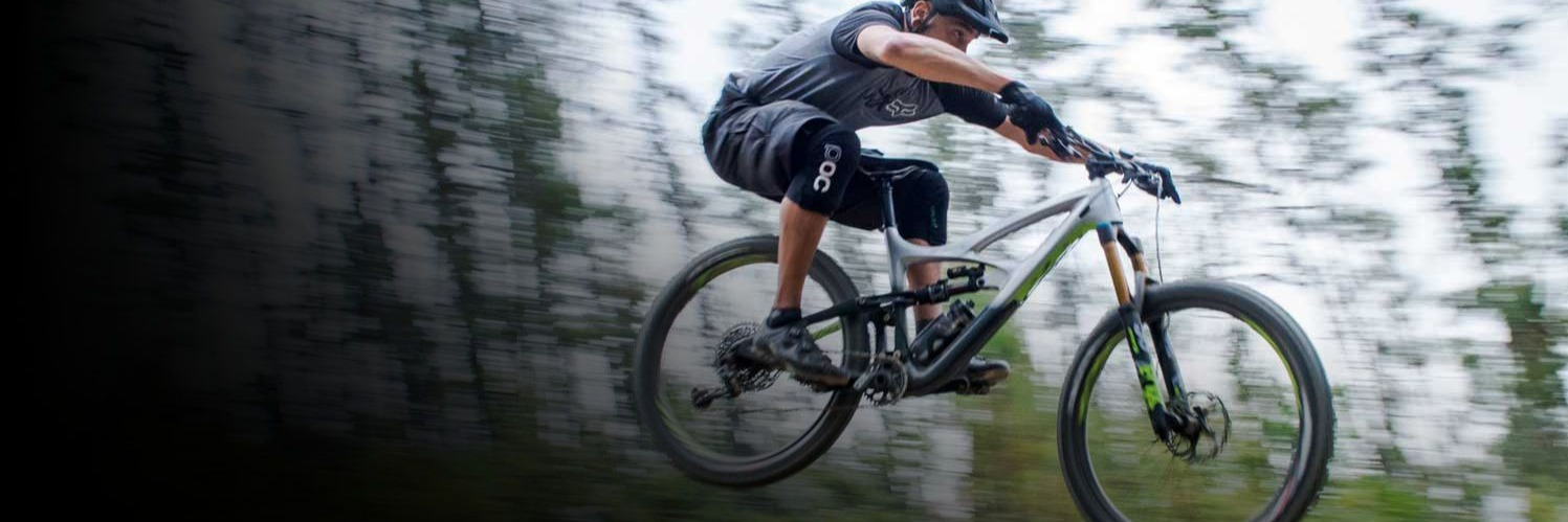 Mountain biker riding an Ibis.