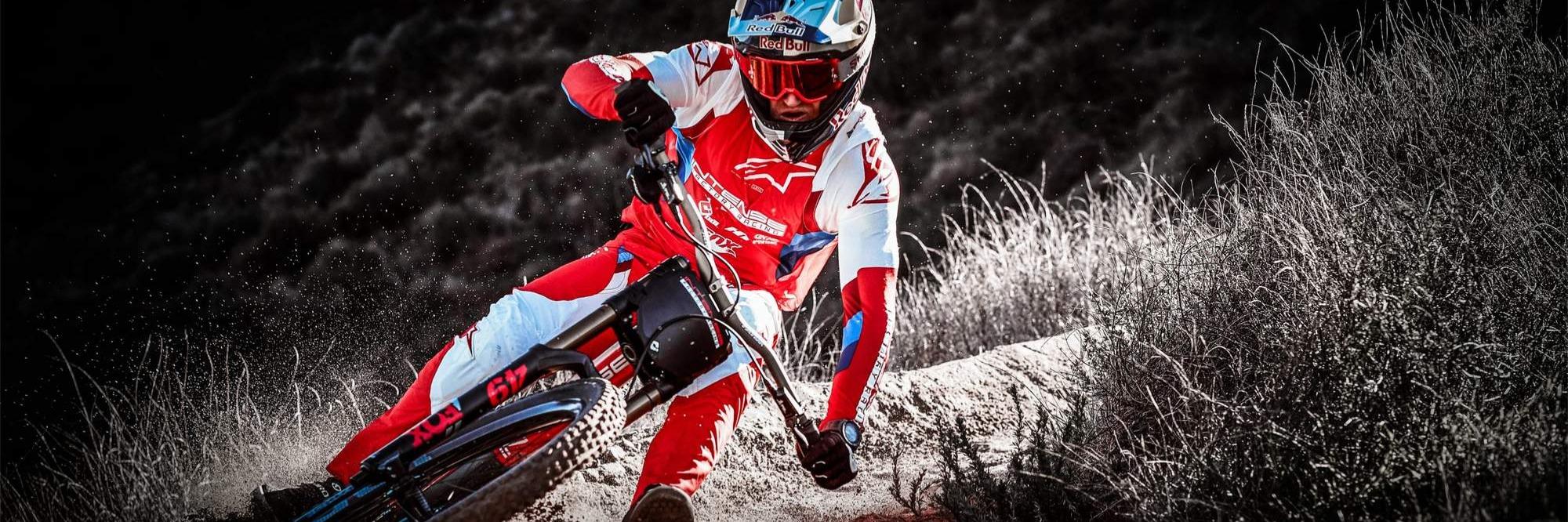 Mountain biker downhilling on an Intense mountain bike.