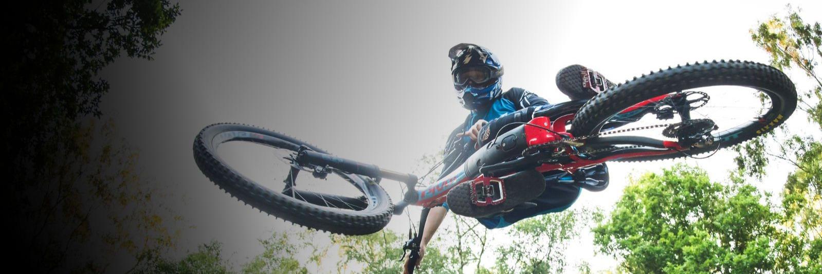 Mountain biker catching air on a Pivot.