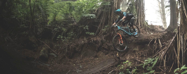 Mountain biker trail riding on a Yeti.