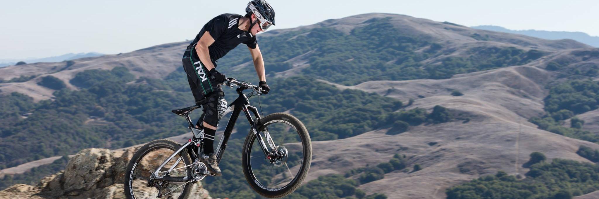 Mountain biker riding a Marin full-suspension bike.