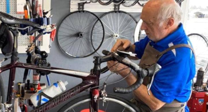 Warren repairing a bike