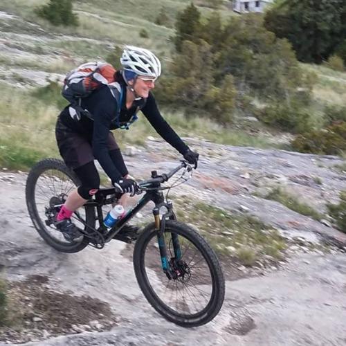 Woman riding a mountain bike.
