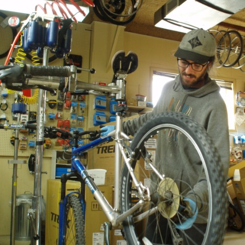 Bike being repaired by a mechanic.