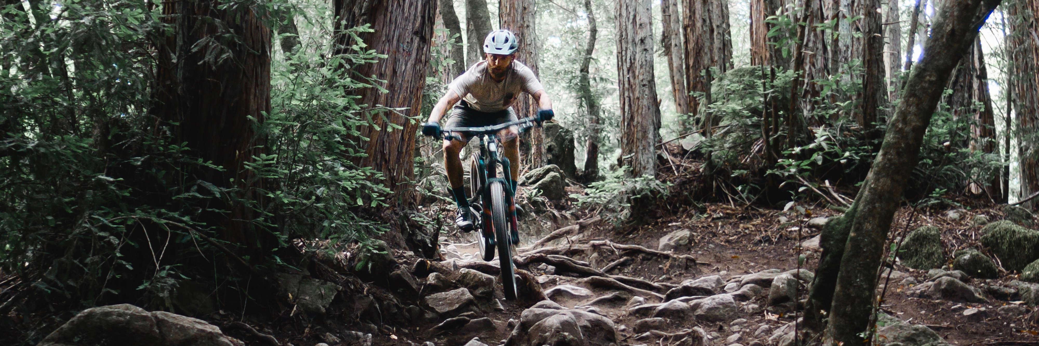 Mountain biker on a rocky trail.