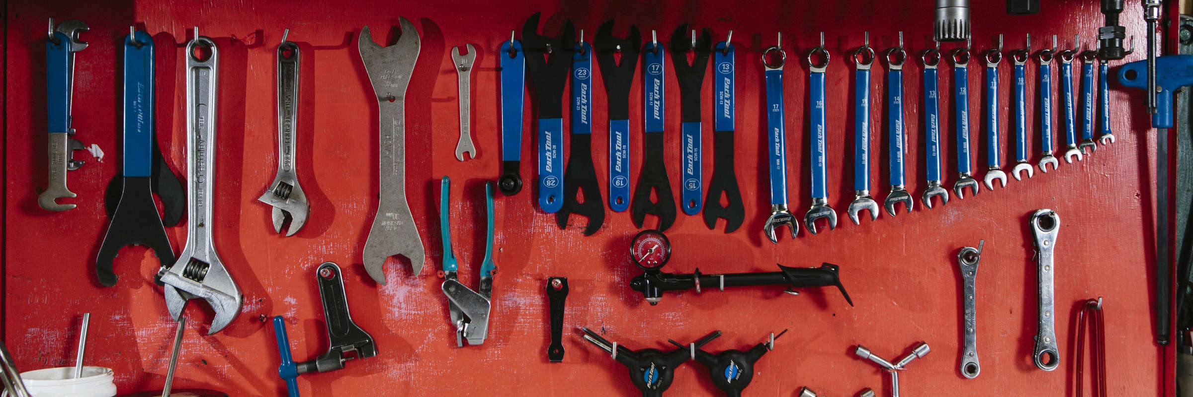Specialty bicycle tools hanging on a workbench