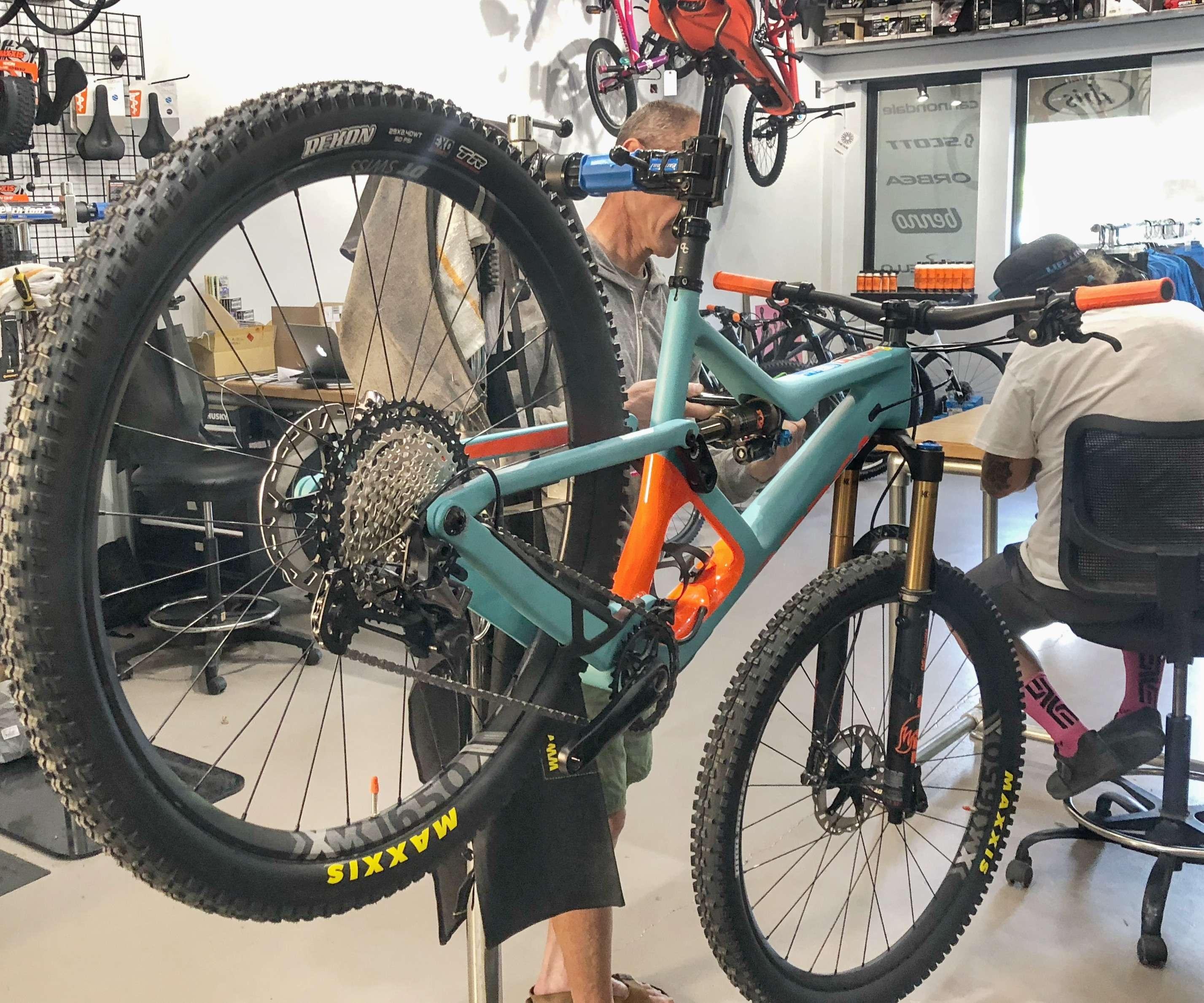 Bike mechanic fixing a mountain bike.