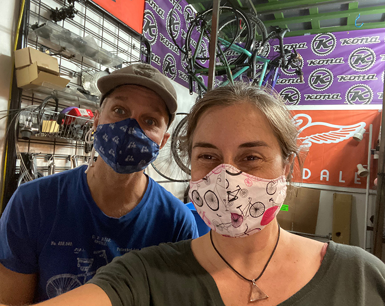 employees wearing bike print masks