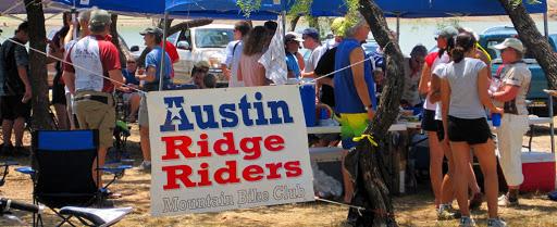 austin ridge riders group photo with banner