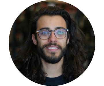 Man with long brown hair and short beard wearing glasses and black tshirt