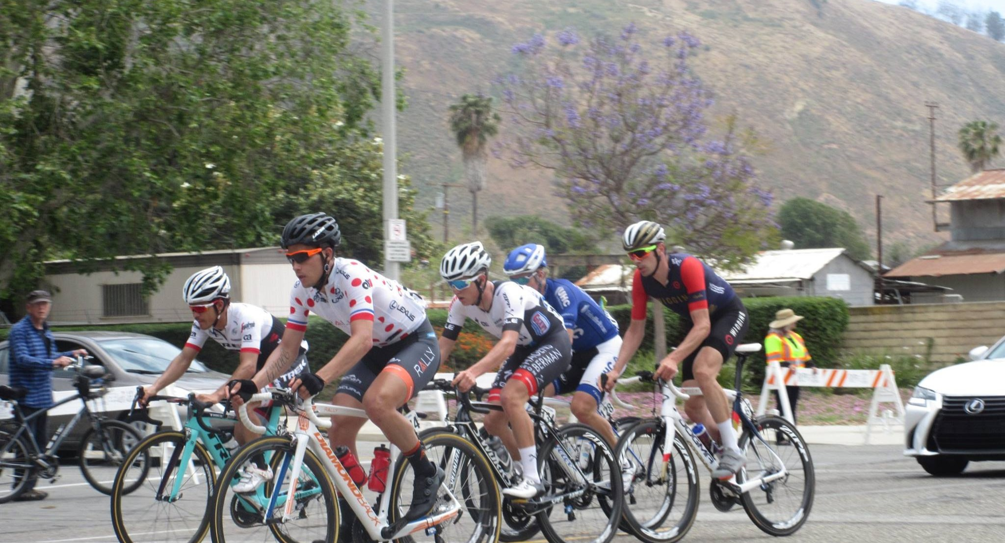 A pack of AmGEN TOC cyclists racing on the streets of Ventura