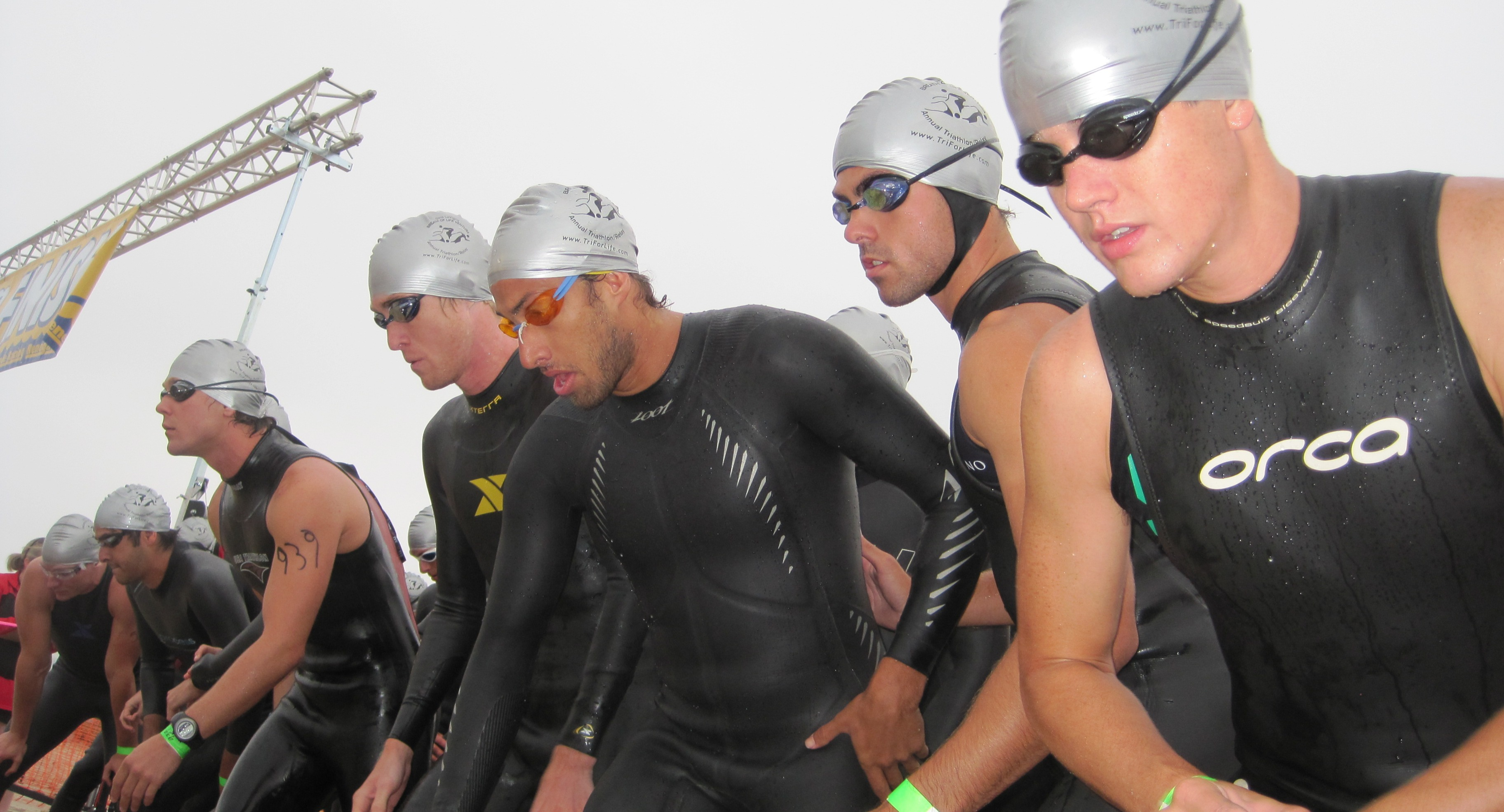 Swimmers lined up at the start of a triathlon