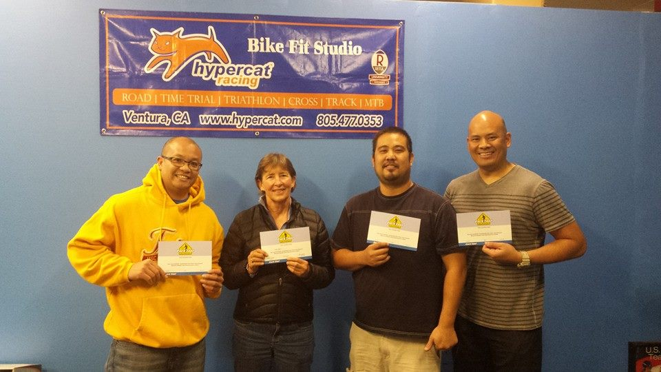 Students hold certificates earned during mechanics class at Hypercat