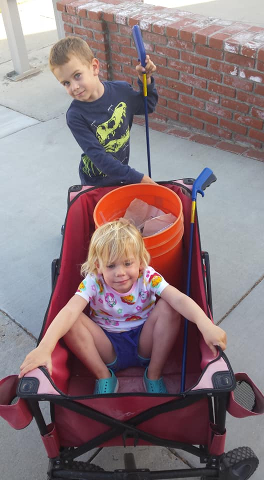 two kids with red wagon