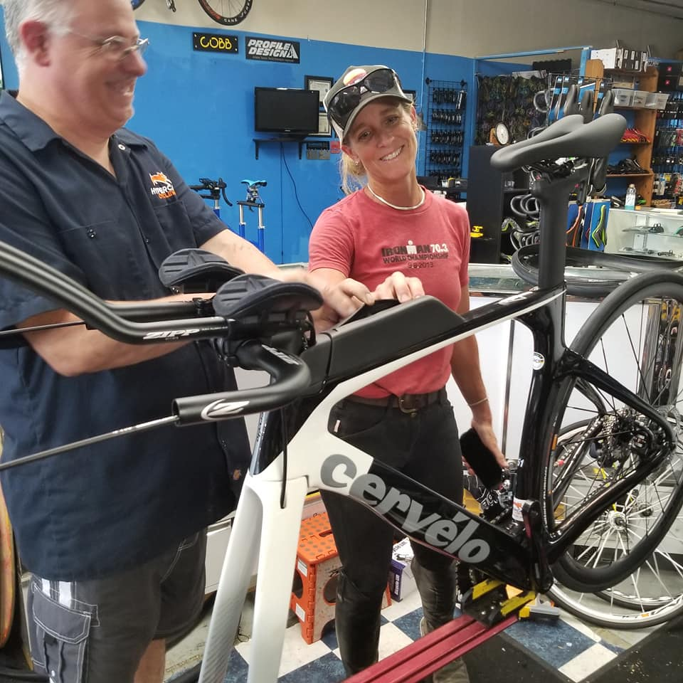 Philip Casanta shows a Hypercat customer her new Cervelo bicycle as it is being built.