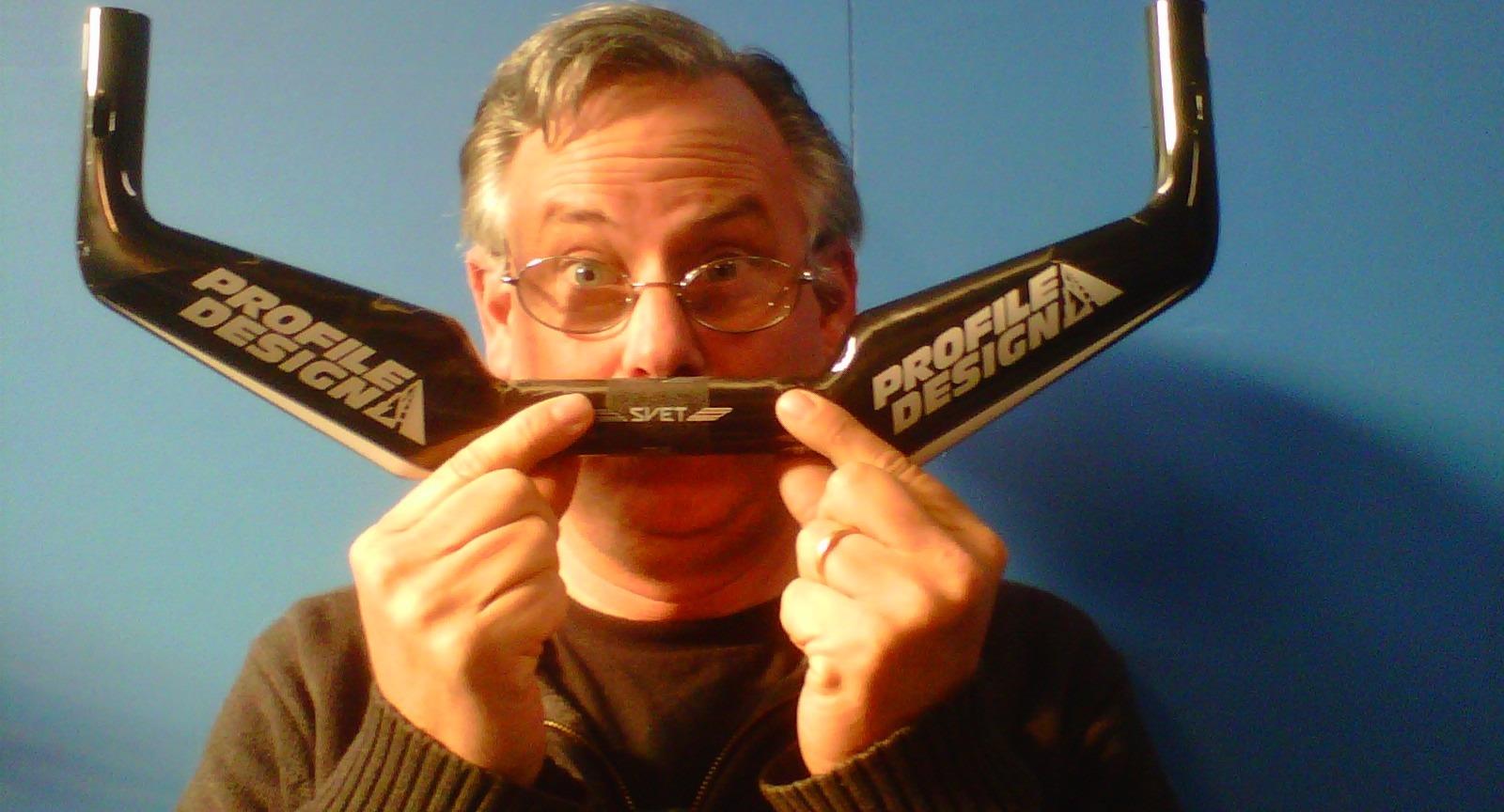 Philip Casanta being goofy using a bike handlebar as a mustache
