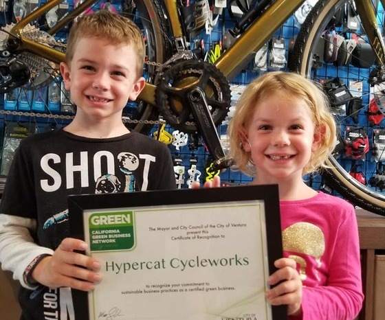 boy and girl holding certificate