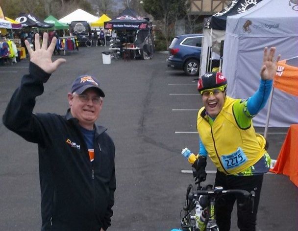 Philip Casanta and Jason Rocha wave in the Solvang Century Expo Area