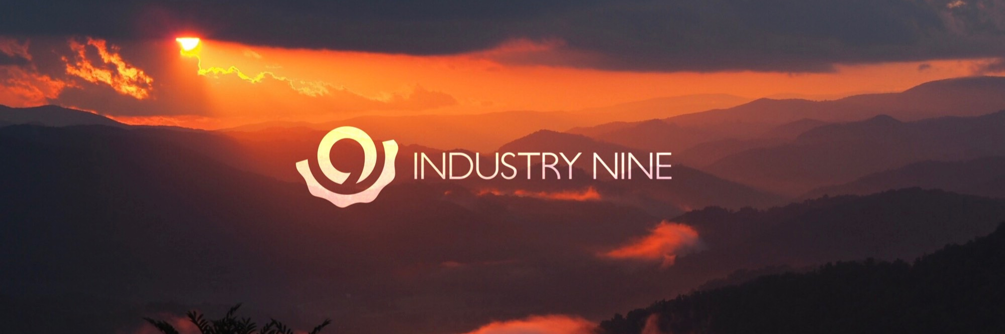 Industry Nine Logo on top of a photo of the Blue Ridge Mountains at sunset.