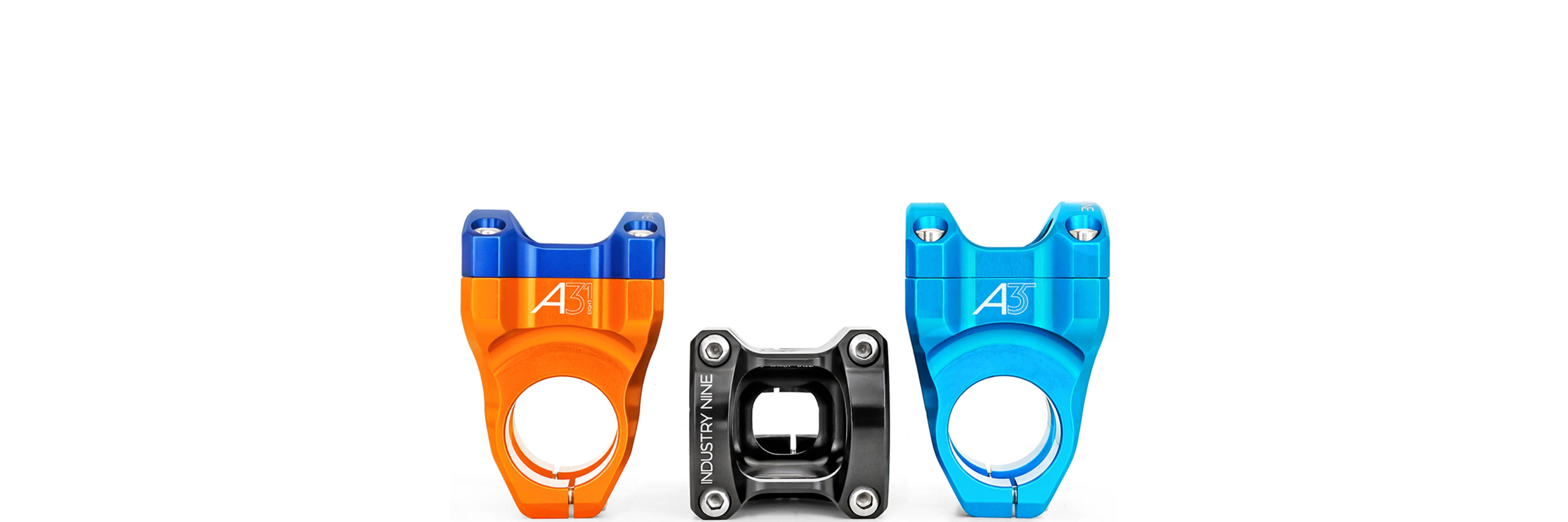 Three Industry Nine stems, one orange with dark blue, one black, and one light blue.