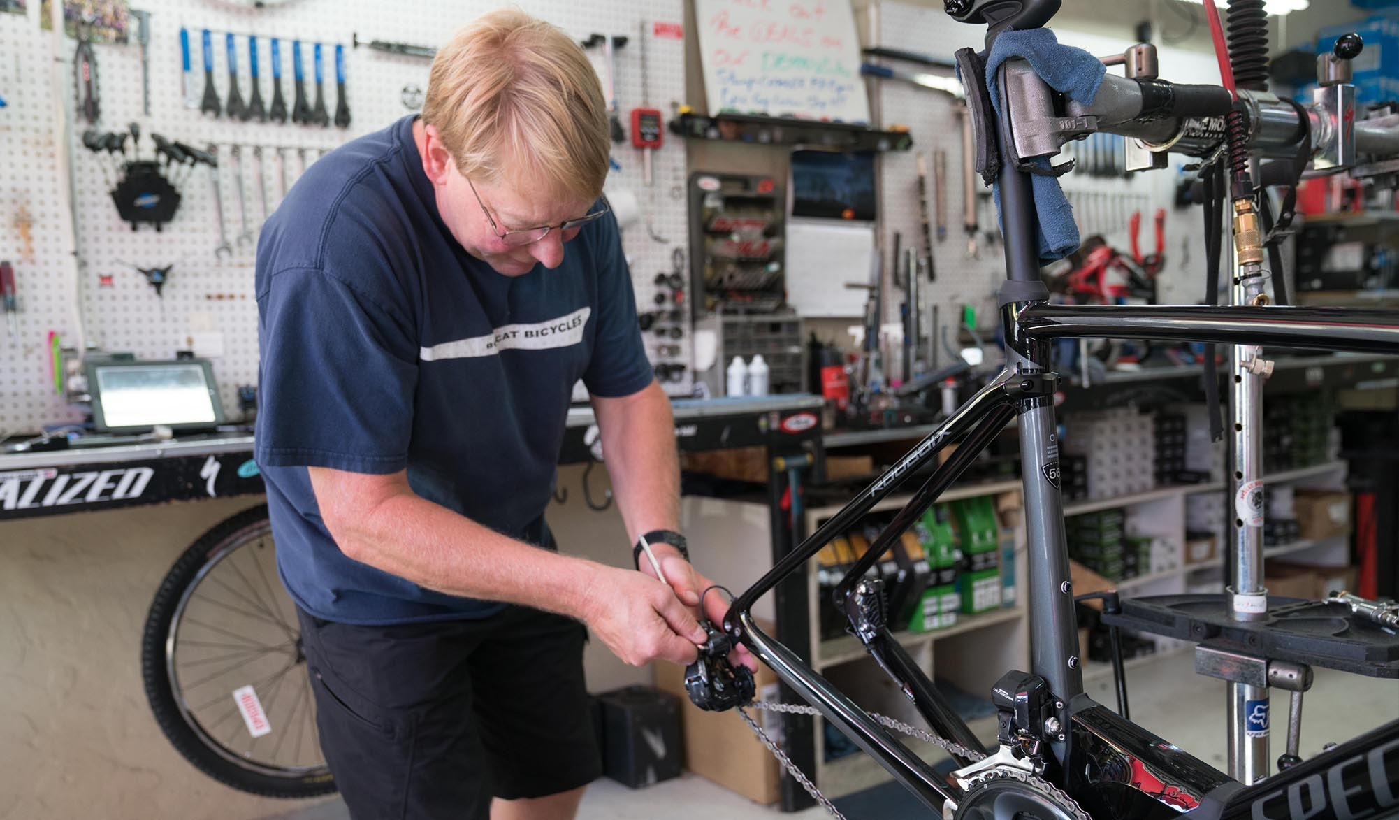 Bobcat Bicycles Mechanic Working on a Bike