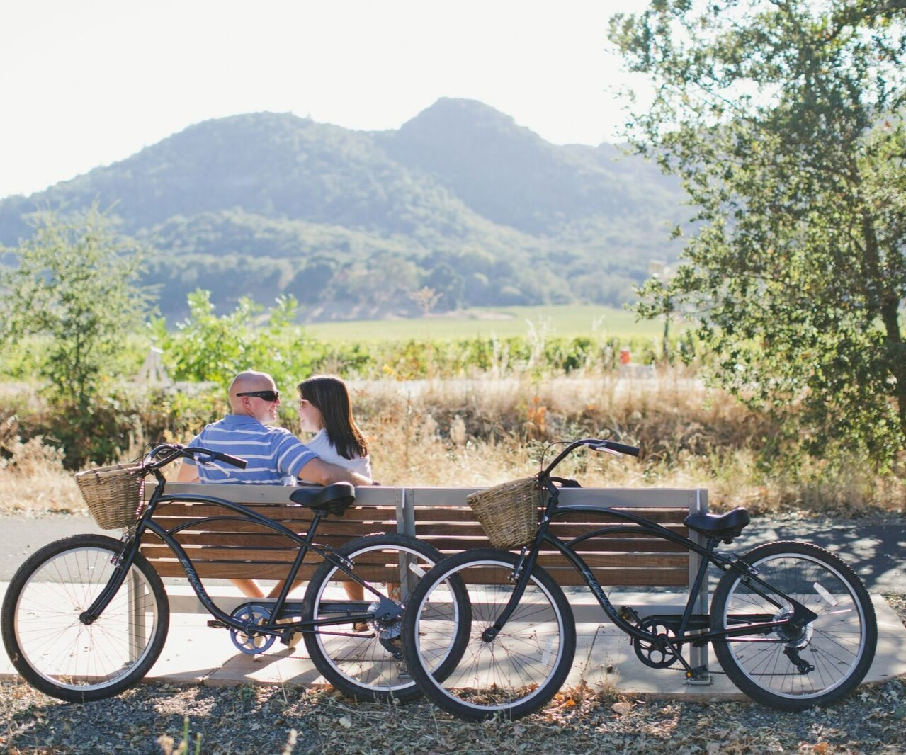 Couple enjoying a romatic bike ride in Napa Valley