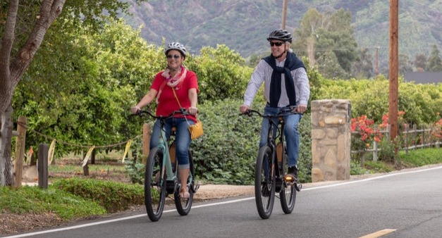 A couple riding eBikes