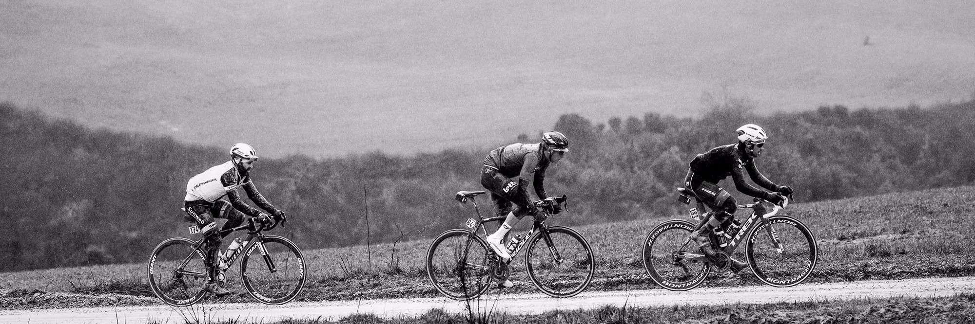 Three road cyclists