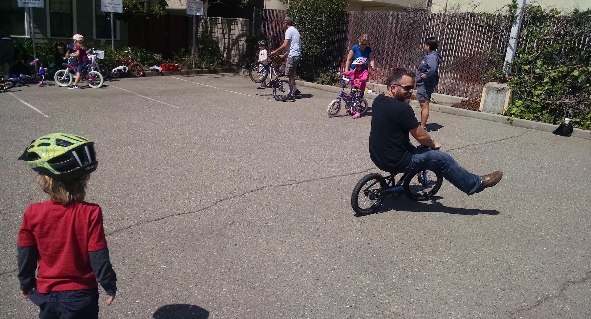 Adult riding a kid's bike