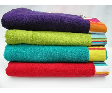 Stack of folded beach towels.
