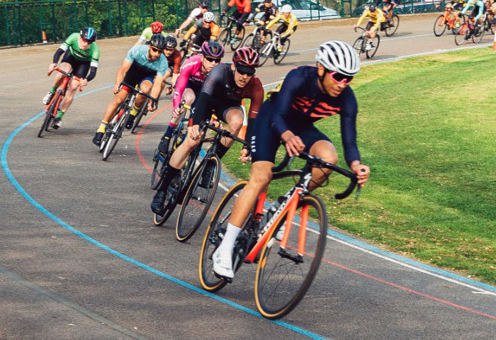 A picture of a group of cyclists riding criterium-style