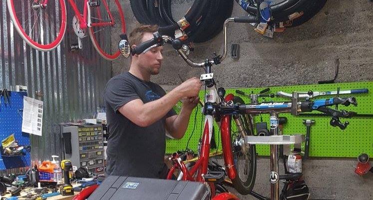 Bike Technician working on an eTrike.