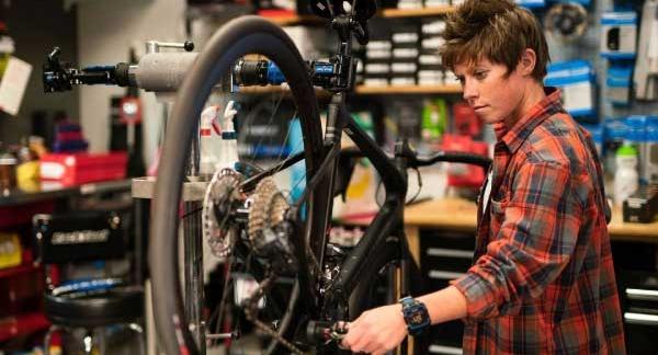 bike mechanic repairing road bike
