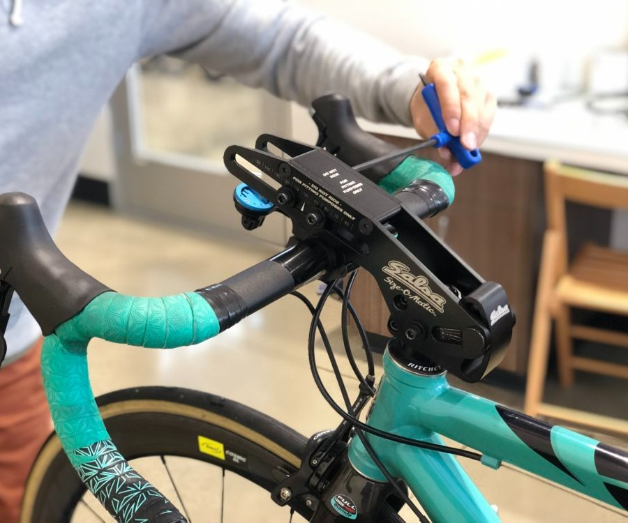 Bicycle Fitter adjusting a road bike handlebar position