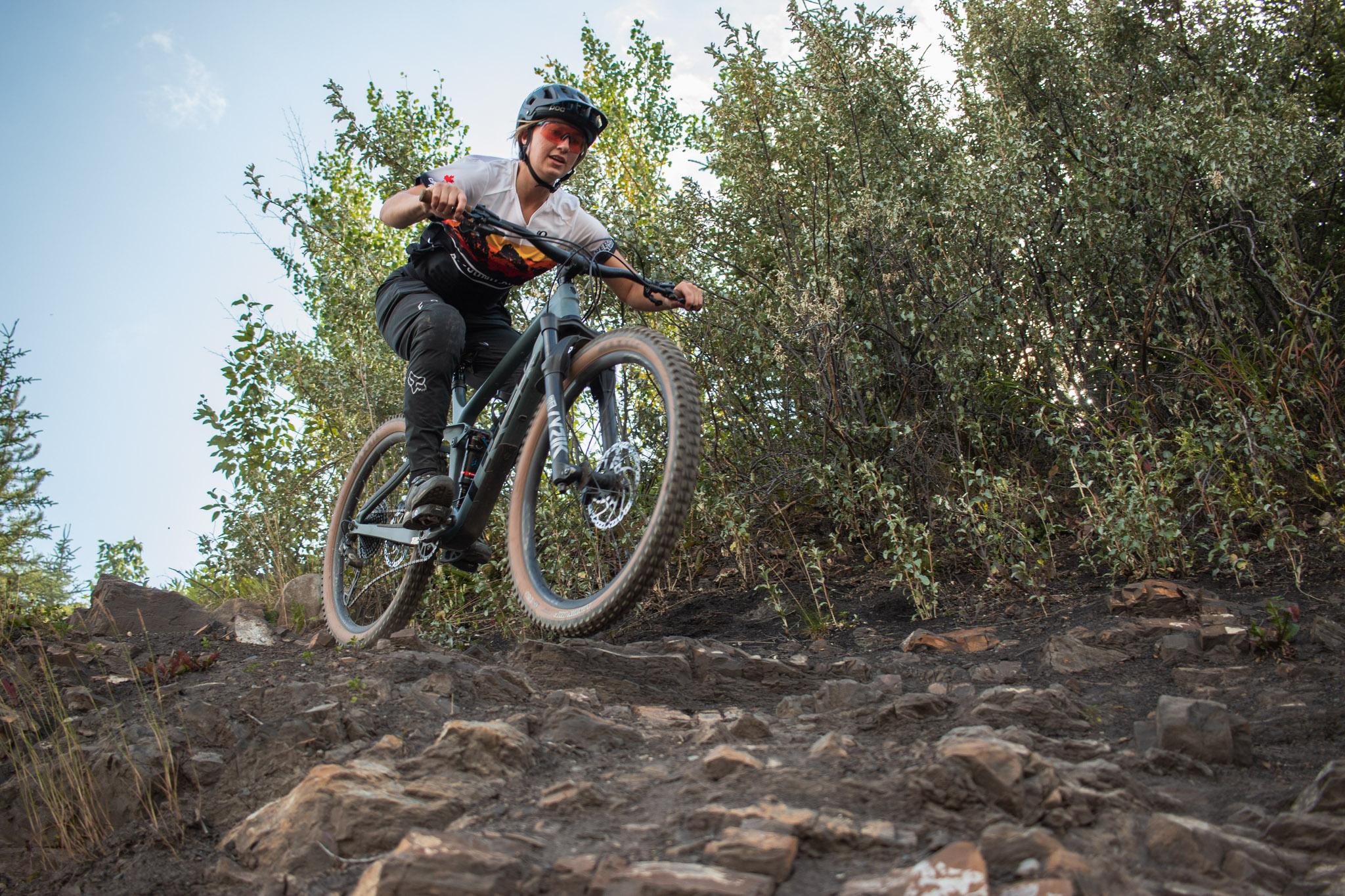 biker riding down hill