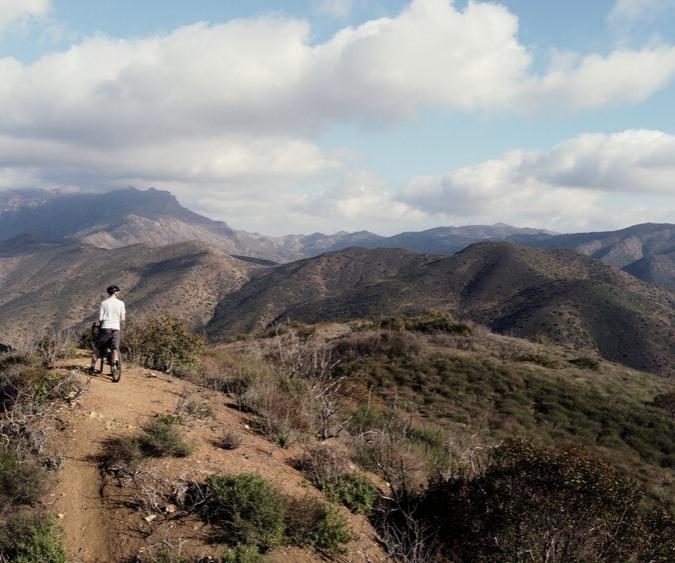 Cyclist enjoying a mountain view