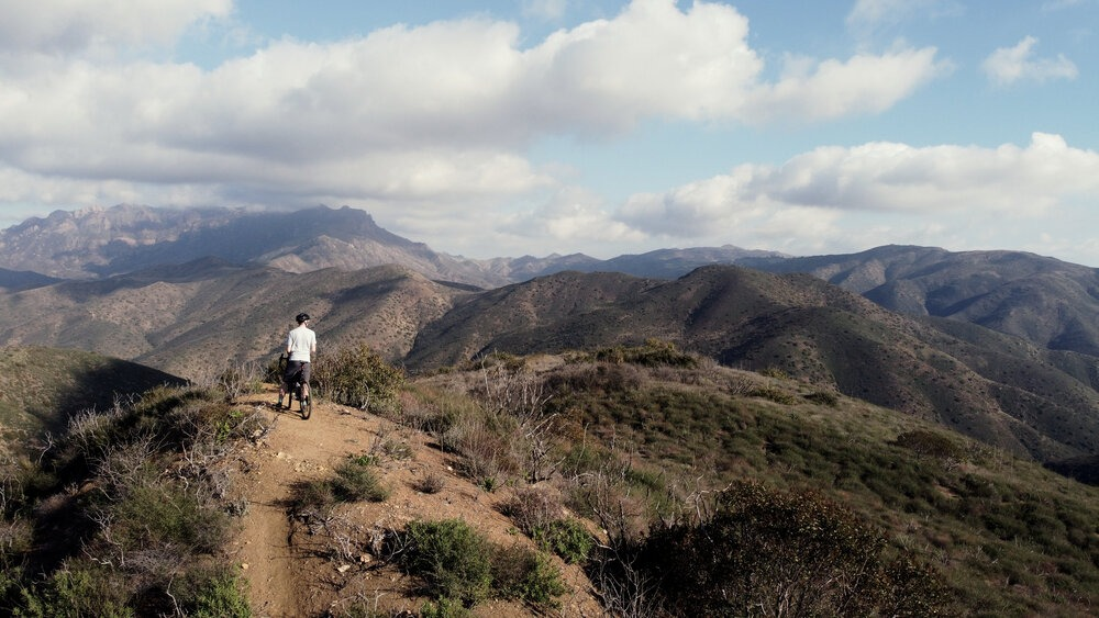 Cyclist enjoying a view of the mountains