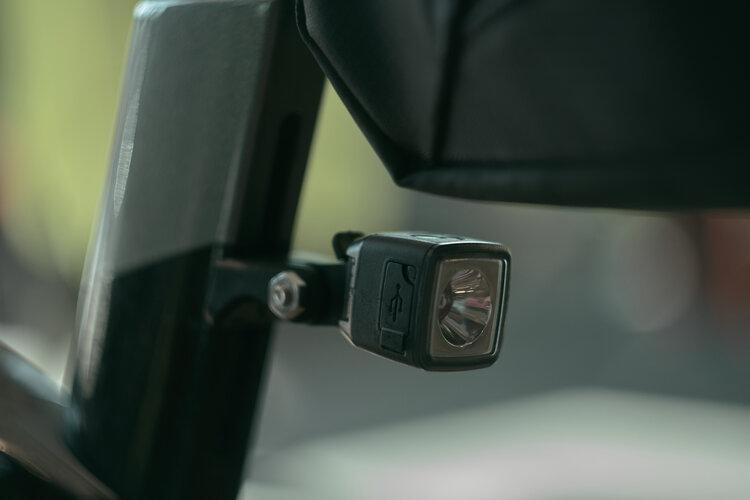 Tail light mounted to seat mast