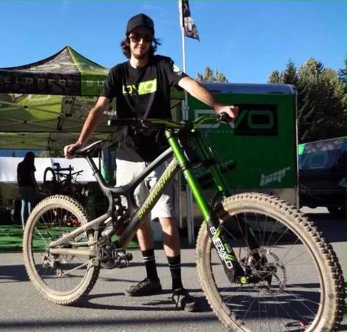 Marshall standing alongside his bike.
