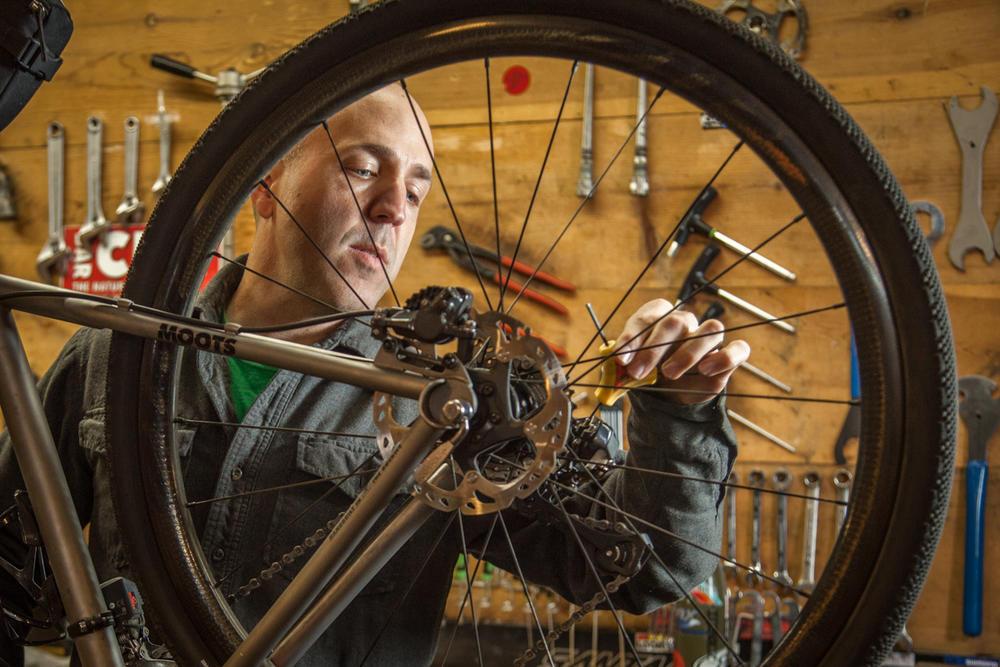 Brad working on a bike