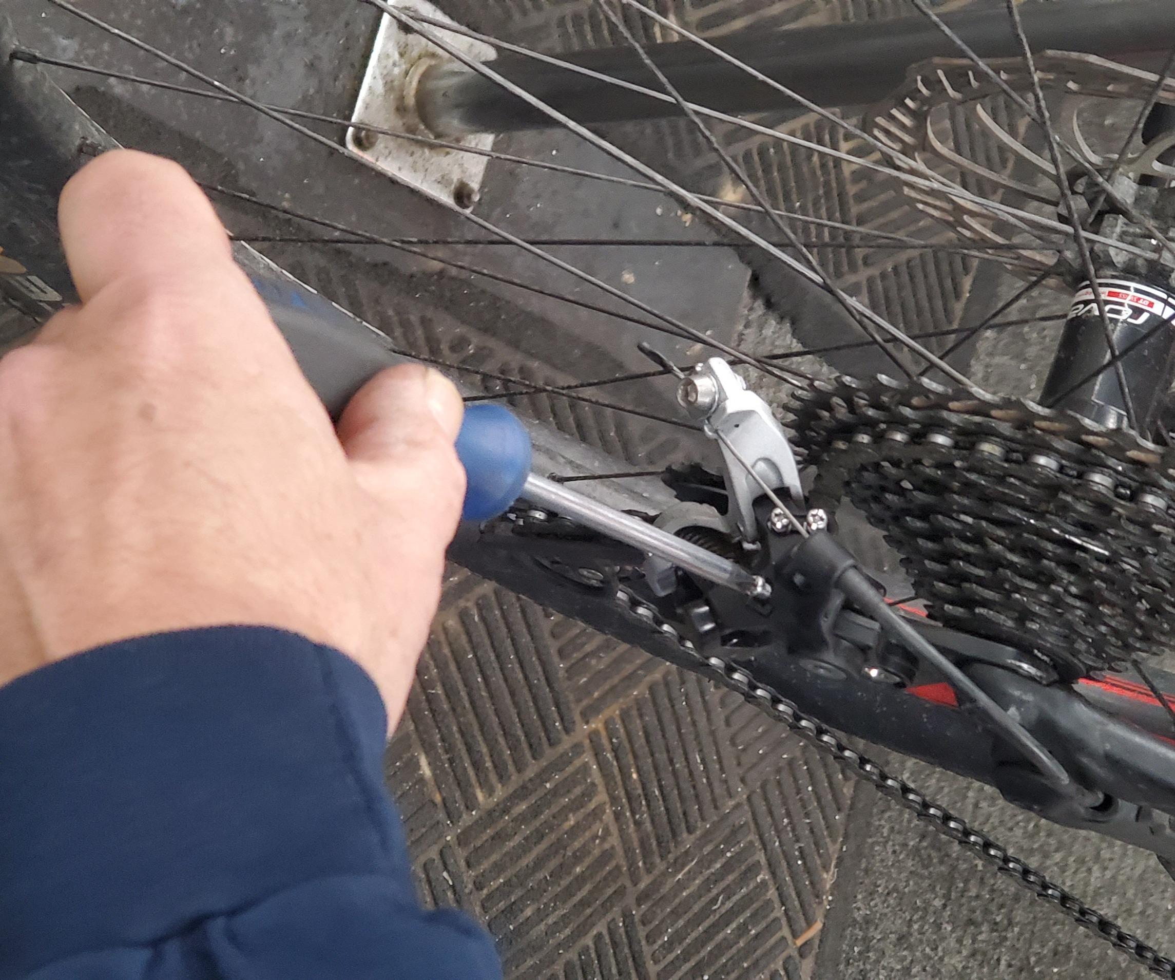 Bike Mechanic making adjustments