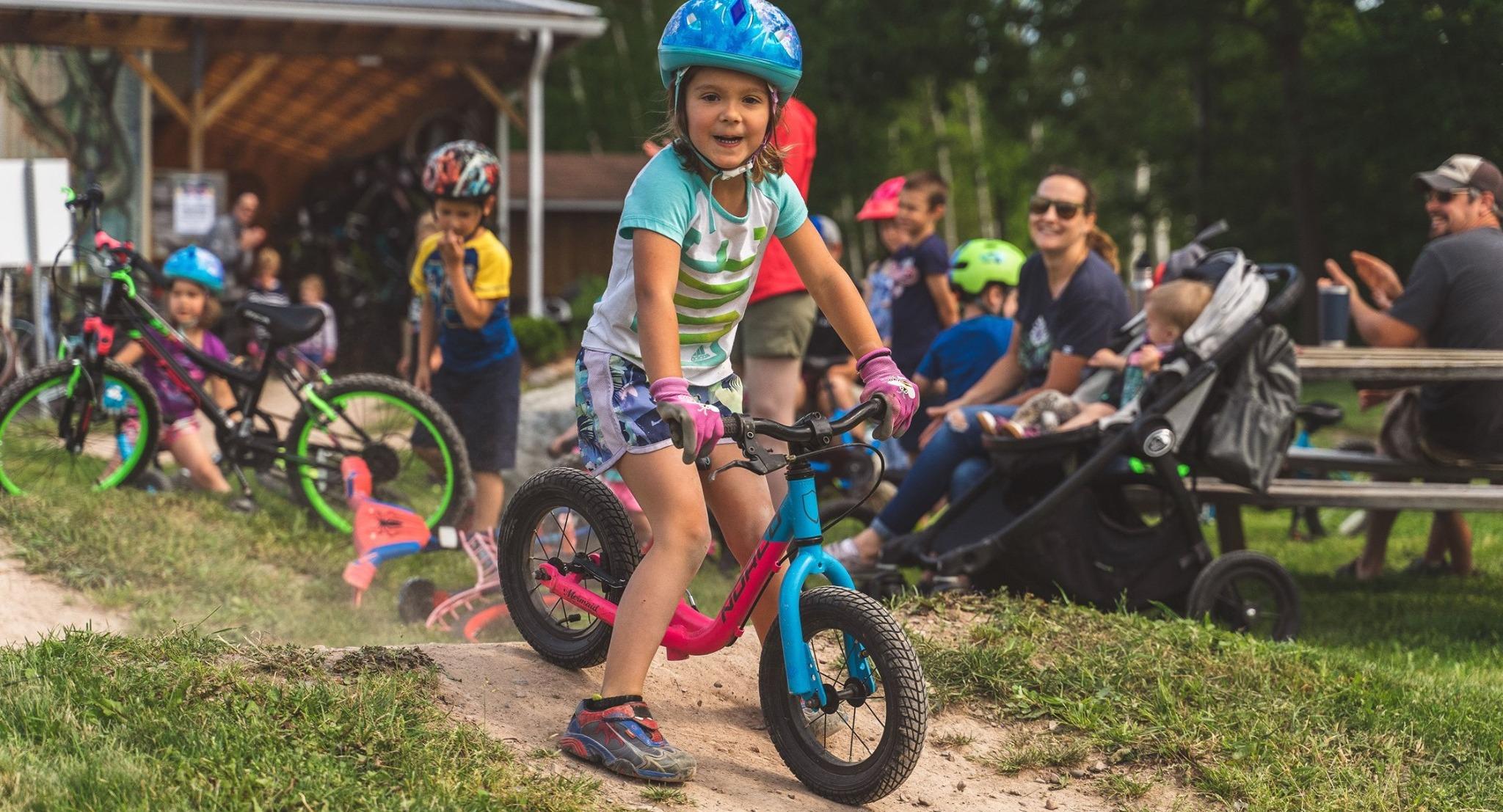 Girl on a balance bike