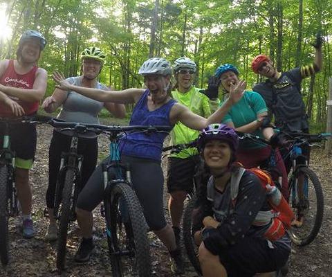 Group of women cyclist on a mountain bike trail