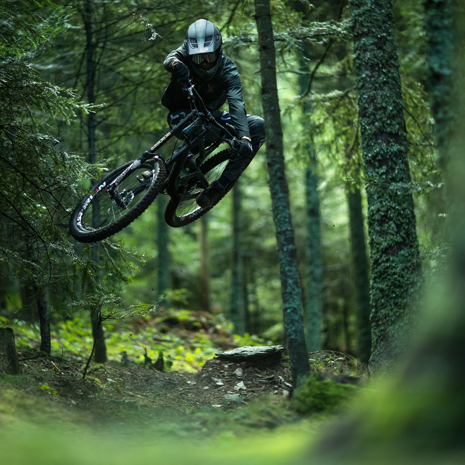 Photo of mountain biker jumping