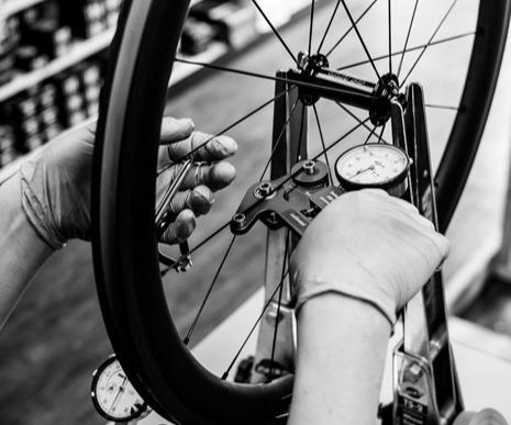 Bike Technician measuring spoke tension