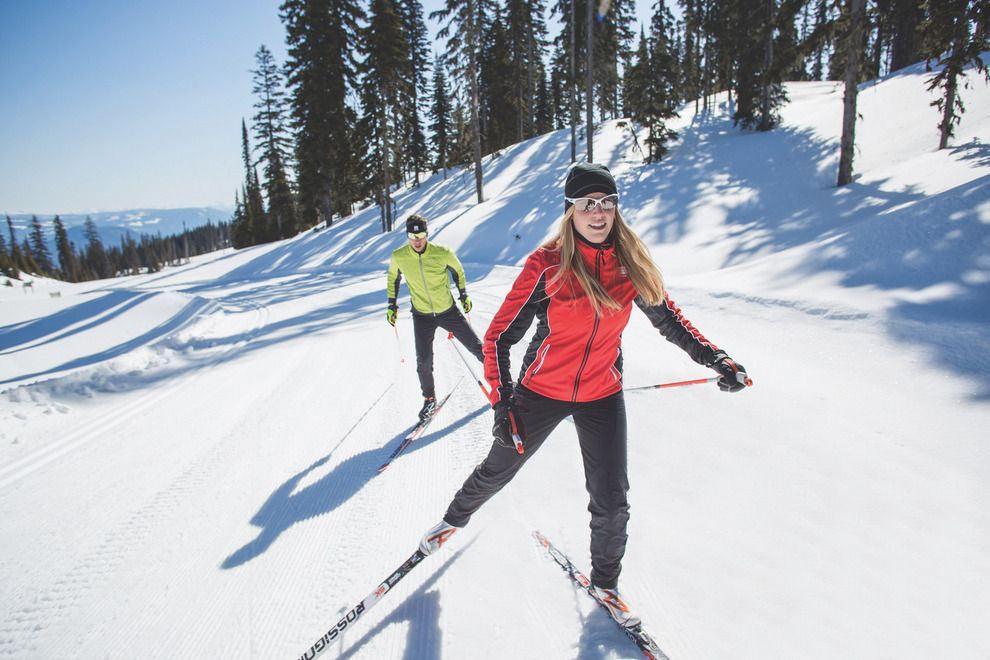 Two people skate ski